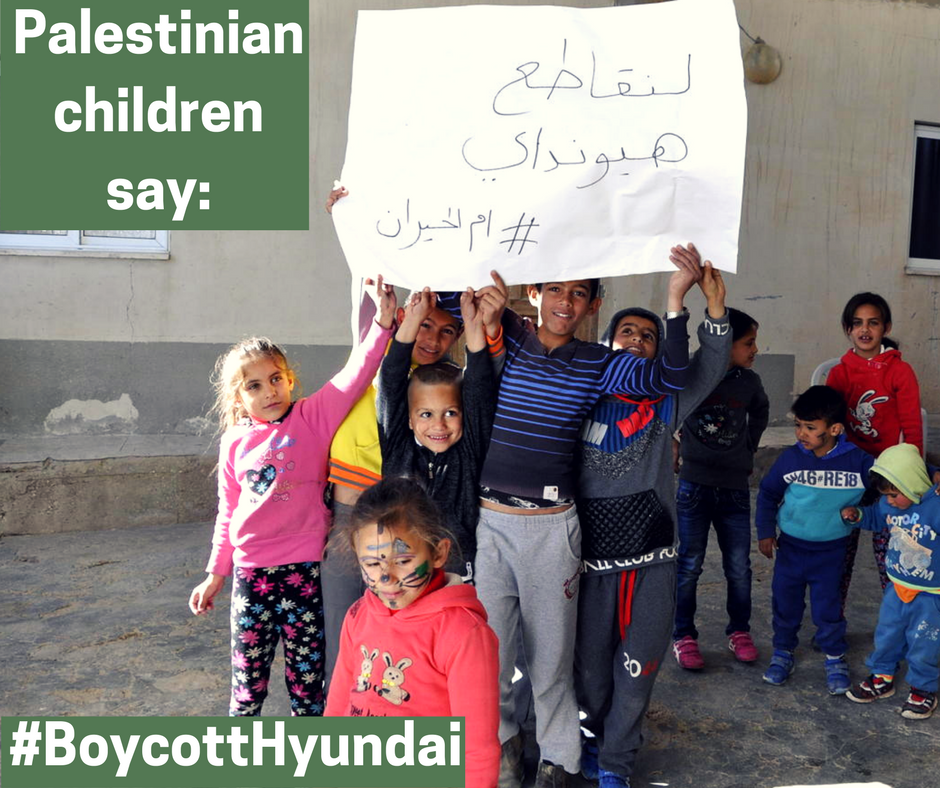 "Children from the village of Umm al-Hiran, facing the imminent demolition of their homes by Israeli authorities using Hyundai bulldozers, carry signs saying, ""Let's boycott Hyundai  #UmmAl-Hiran"" (Credit: Sahar Rouhana, 2017)"