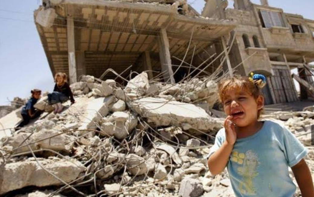 Gazan girl in front of ruins of destroyed home