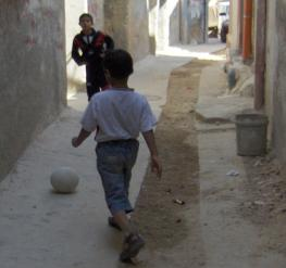 Palestinian boys playing footballl in al-Amari refugee camp