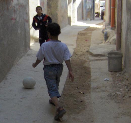 Palestinian boys playing footballl in al-Amari refugee camp