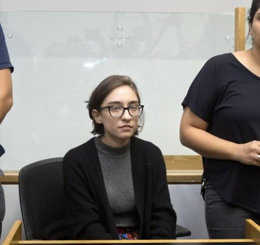Lara Alqasem sits in a courtroom prior to a hearing at the district court in Tel Aviv, Thursday, Oct. 11, 2018. (Photo: Sebastian Scheiner / AP)