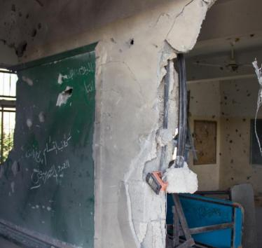 A classroom in Gaza destroyed in Israel's 2014 attacks. Credit: Active Stills, Basel Yazouri